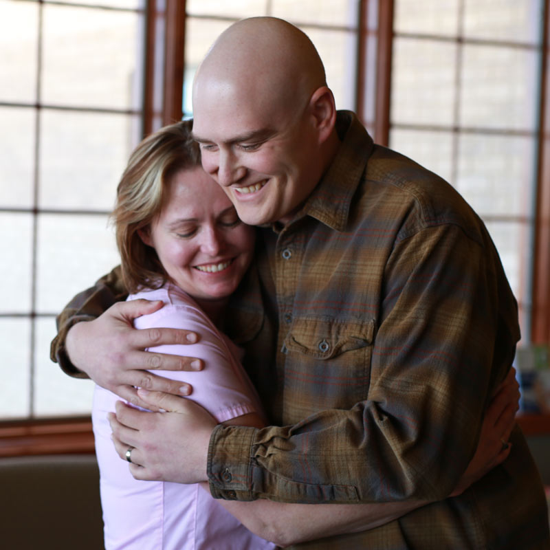 Cody Wood hugs his chemotherapy nurse after receiving treatment